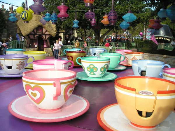 Spinning teacups at an amusement park